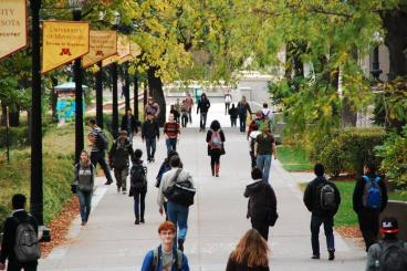 Students walk around UMN-TC campus