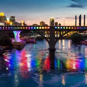Bridges over the Mississippi River display rainbow lights during Pride Month